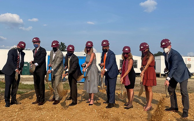 Gov. Ralph Northam, second from left, and Alexandria Mayor Justin Wilson, fourth from left, are joined by local dignitaries and development officials at the Sept. 14 groundbreaking for the Virginia Tech Innovation Campus at Potomac Yard.
