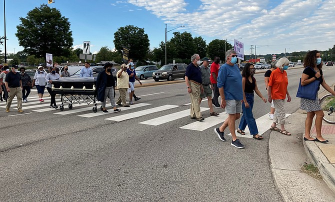 Gum Springs residents protest the Richmond Highway widening project.