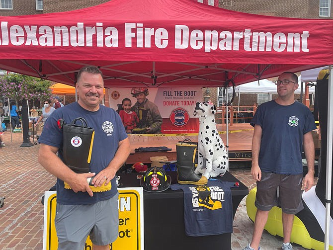 Firefighter Michael Kort, left, stands ready to collect donations Sept.4 at Market Square as part of the annual Fill the Boot campaign benefitting the Muscular Dystrophy Association.