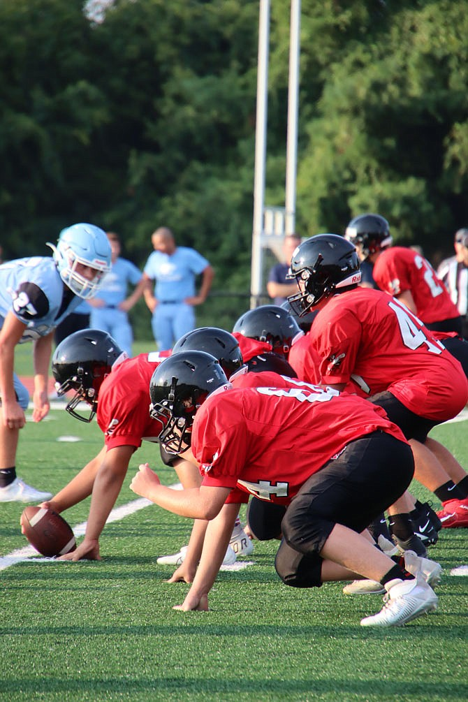 Herndon High School's offensive line squares up against South Lakes