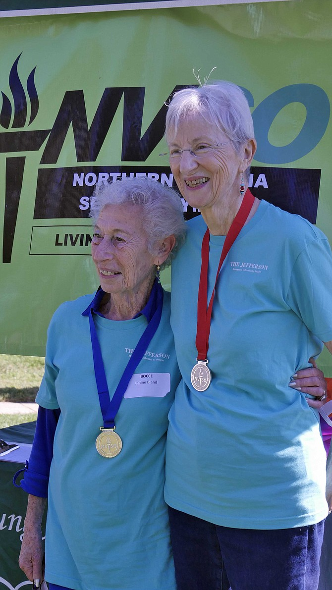 Janine Bland (left) takes gold and Barbara Scholtz the silver at Fairfax City Senior Center Green Acres on Saturday, Oct. 1. Both are residents at the Jefferson in Arlington.