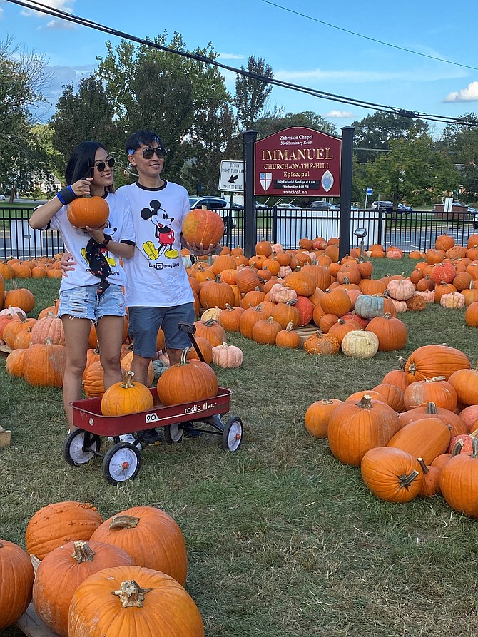 Chatchaya Pansiri and Warawat Prachongkarn hold up some of the pumpkins selected Oct. 4 at the Immanuel Church-on-the-Hill Pumpkin Patch.