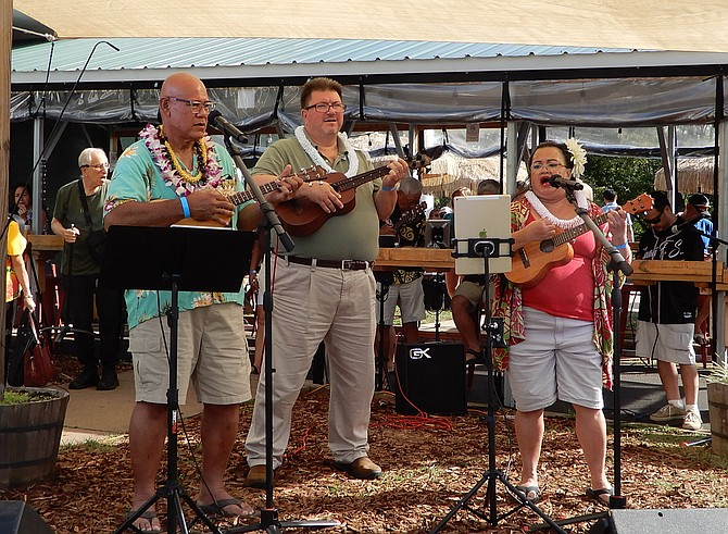 Performing is a group called Naniukulelejoy.