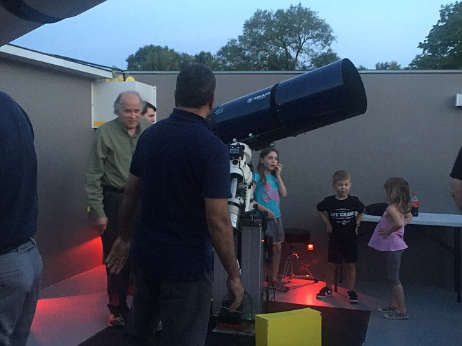 A visitor to Observatory Park at Turner Farm enjoys use of one of the large telescopes.