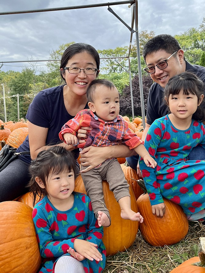 """From left, Bella Pan, 3 of Vienna, mom, Jang, baby Jeremy, 9- months, Lexie, 5, and dad, Justin, enjoy their """"family outing with the awesome weather,"""" as Jang says. Asked if they will choose a pumpkin, Lexie says, """"We're growing our own pumpkins."""""""