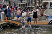 CLICK IMAGE TO PLAY    On Saturday, Feb. 4, 185 hearty souls jumped into the 40 degree water of Lake Anne at Lake Anne Plaza to raise over $73,000 for Camp Sunshine.